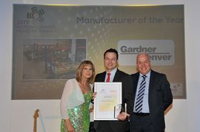 Tom Green (centre), marketing manager – Industrials at Gardner Denver, collects  the Manufacturer of the Year award at the 2019 Motion Control Industry Awards.