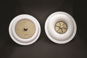 Wilden's new full stroke PTFE (Teflon) diaphragms  (pictured on left) provide increased product displacement per stroke versus older, lower-flowing models (pictured on right).
