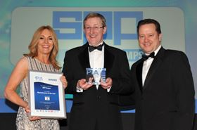 Ken Winn, operations director of SPP, accepts the award for 'Manufacturer of the Year'. PIA host, Helen Prospero, is on the left and category sponsor Jonathan Wilkinson, CEO of AESSEAL plc, is on the right.