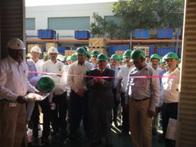 Cutting the ribbon at the opening of Kirloskar's new warehouse in Kirloskarvadi