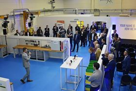 Benjamin Nys, Sales Manager Belgium (John Crane), gives a speech as John Crane team members and customers gather on the facility floor.