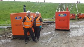 Simon Flevill service engineer/driver(left) and Ian Turner, supervisor Service (right) with the diesel pumps draining water out of Toddbrook.
