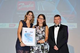 Sara Bernard, centre, UK marketing and business support at Danfoss is presented with the Judges' Special Award at the 2018 Pump Industry Awards by  journalist and presenter, Andrea Byrne. Alex Onslow, commercial manager, Flowserve SIHI, who sponsored the award, is on the right.