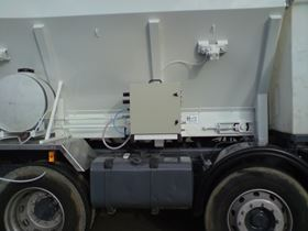 Foam generator side mounted to concrete mixer.