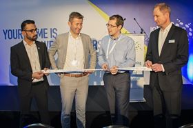 Left to right: Esmatullah Az imi, After Sales Technician (John Crane); Benjamin Nys, Sales Manager Belgium (John Crane); Lieven Van Belleghem, Reliability Engineer, Expertise Process Machinery (BASF); and Nico Schmaeling, Vice President Sales Europe (John Crane), cut the ribbon to officially open John Crane's new Antwerp facility.