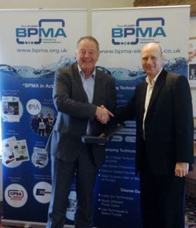 The newly elected president of the BPMA, Peter Reynolds (left), presents a token of thanks to Andy Ratcliffe (right), for his services during his presidency.