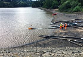 The flexible hoses extracting water at the Toddbrook Reservoir.