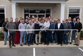 Cutting the ribbon at the opening of the new John Crane service centre in Mobile, Alabama.