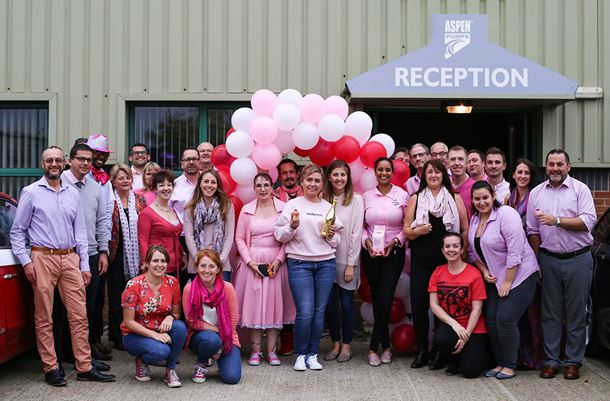 Aspen Pumps staff pictured raising money on 'Wear it Pink' day to fund breast cancer research.