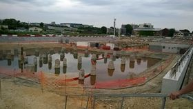 Partial view of the Metro construction site in Saint Quen: Two temporary basins containing contaminated groundwater in the foreground. (©Tsurumi)