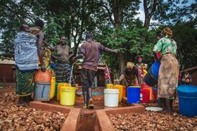 Community members in Zeze, Tanzania collect safe, clean water from Grundfos technology and solar-powered water systems installed by Water Mission. Photo: Water Mission.