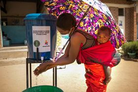 A woman washes her hands upon arrival at Namanolo Health Centre in Balaka Southern Malawi in November 2020. Photo: Thoko Chikondi.