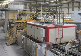 "Vibrating press in a ""Diresco Stone"" production line with Busch vacuum unit installed above the press."
