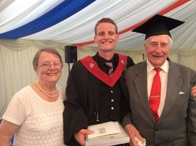 Jamie at his graduation in 2014 with his grandparents, Peter and Sheila Knight.