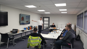 Matthew Hill with participants on the Tsurumi pump training course in Glasgow.