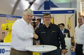 Gregory Yeakle, managing director of Milton Roy EMEA, and Andy Anderson, region president of Proserv Middle East.