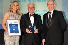 John Veness (center), general manager for ITT's Goulds Pumps brand in the UK, accepts the British Pump Manufacturers' Association's Lifetime Achievement Award from BPMA President Andy Ratcliffe (right) and ceremony host Helen Fospero.