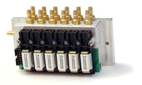 The Hargraves 10 mm Magnum solenoid valves, seen here manifold mounted, can be configured with a large orifice (0.075 in/1.9 mm) providing the pump with a less-restrictive flow path.