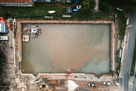 A new rainwater retention basin where divers pump cement and sludge out before the underwater concrete floor is installed. (Image: Tsurumi)