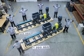 Netzsch workers celebrate the company's one millionth pump.