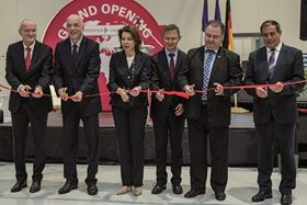 Cutting the ribbon at the inauguration ceremony.