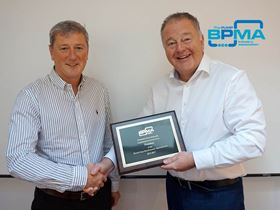 Duncan Lewis (left), the new president of the BPMA, presenting past president Peter Reynolds (right) with a plaque thanking him for his service.